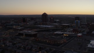 DX0002_123_015 - 5.7K stock footage aerial video passing Albuquerque Plaza and Hyatt Regency at sunset, Downtown Albuquerque, New Mexico
