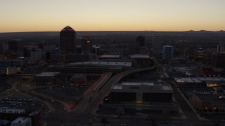 DX0002_123_016 - 5.7K stock footage aerial video flying by Albuquerque Plaza, Hyatt Regency and city high-rises at sunset, Downtown Albuquerque, New Mexico