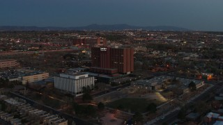 DX0002_123_019 - 5.7K stock footage aerial video fly toward and orbit a hospital at twilight in Albuquerque, New Mexico