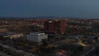 DX0002_123_021 - 5.7K stock footage aerial video of a reverse view of a hospital complex at twilight in Albuquerque, New Mexico