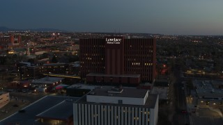 DX0002_123_022 - 5.7K stock footage aerial video approach a hospital building at twilight in Albuquerque, New Mexico