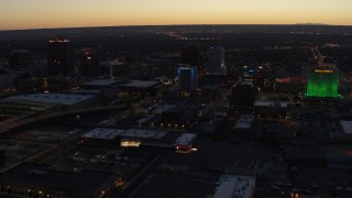 DX0002_123_025 - 5.7K stock footage aerial video flyby hotel and nearby office buildings at twilight, Downtown Albuquerque, New Mexico