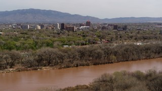 DX0002_124_001 - 5.7K stock footage aerial video of high-rise office buildings seen from the Rio Grande, Downtown Albuquerque, New Mexico