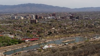 DX0002_124_003 - 5.7K stock footage aerial video wide view of high-rise office buildings seen from Tingley Beach, Downtown Albuquerque, New Mexico