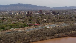 DX0002_124_009 - 5.7K stock footage aerial video of high-rise office buildings seen from city park, Downtown Albuquerque, New Mexico