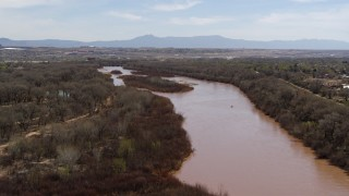DX0002_124_013 - 5.7K stock footage aerial video of flying away from islands in the Rio Grande river in Albuquerque, New Mexico