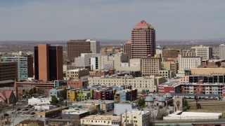 DX0002_124_024 - 5.7K stock footage aerial video of Albuquerque Plaza office high-rise and neighboring buildings, Downtown Albuquerque, New Mexico