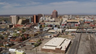 DX0002_124_030 - 5.7K stock footage aerial video flyby train tracks, focus on Albuquerque Plaza and surrounding buildings, Downtown Albuquerque, New Mexico