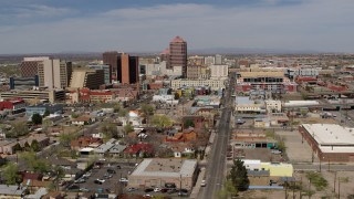 DX0002_124_031 - 5.7K stock footage aerial video flyby and away from Albuquerque Plaza and surrounding buildings, Downtown Albuquerque, New Mexico