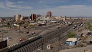 DX0002_124_040 - 5.7K stock footage aerial video of distant office buildings seen from railroad tracks, Downtown Albuquerque, New Mexico