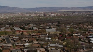 DX0002_126_007 - 5.7K stock footage aerial video flyby a suburban neighborhood with Downtown Albuquerque in the distance, New Mexico