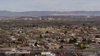 DX0002_126_011 - 5.7K stock footage aerial video of Downtown Albuquerque, seen from suburban homes, New Mexico