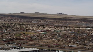 DX0002_126_014 - 5.7K stock footage aerial video of suburban neighborhood and elementary school across freeway in Albuquerque, New Mexico