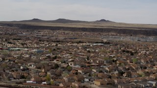 DX0002_126_018 - 5.7K stock footage aerial video of descend past suburban neighborhood, reveal freeway, Albuquerque, New Mexico