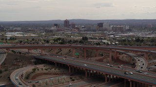 DX0002_126_020 - 5.7K stock footage aerial video of Downtown Albuquerque seen from a freeway interchange, New Mexico