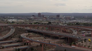 DX0002_126_022 - 5.7K stock footage aerial video of Downtown Albuquerque seen while passing by freeway interchange, New Mexico
