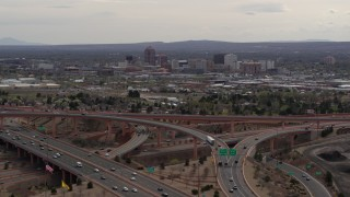 DX0002_126_024 - 5.7K stock footage aerial video of Downtown Albuquerque seen while ascending near freeway interchange traffic, New Mexico