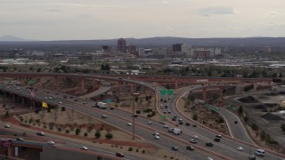 DX0002_126_027 - 5.7K stock footage aerial video of Downtown Albuquerque buildings seen from freeway interchange traffic, New Mexico