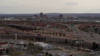 DX0002_126_032 - 5.7K stock footage aerial video of Downtown Albuquerque buildings seen from a freeway interchange, New Mexico