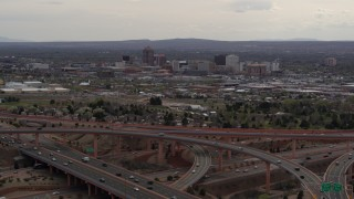 DX0002_126_033 - 5.7K stock footage aerial video approach freeway interchange, ascend for view of Downtown Albuquerque, New Mexico