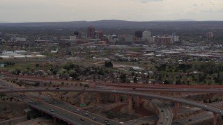 DX0002_126_034 - 5.7K stock footage aerial video of Downtown Albuquerque high-rises seen from freeway interchange, New Mexico
