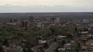 DX0002_126_035 - 5.7K stock footage aerial video of ascending from residential street to focus on Downtown Albuquerque, New Mexico