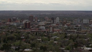 DX0002_126_036 - 5.7K stock footage aerial video of the city's high-rise buildings seen from neighborhood, Downtown Albuquerque, New Mexico