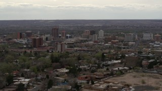 DX0002_126_037 - 5.7K stock footage aerial video reverse view of city's high-rise buildings seen from neighborhood, Downtown Albuquerque, New Mexico