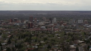 DX0002_126_038 - 5.7K stock footage aerial video of the city's high-rise buildings seen from neighborhood, Downtown Albuquerque, New Mexico
