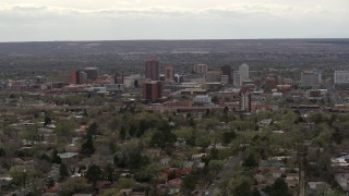 DX0002_126_039 - 5.7K stock footage aerial video of the city's high-rise buildings seen while passing by neighborhood, Downtown Albuquerque, New Mexico