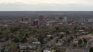 DX0002_126_040 - 5.7K stock footage aerial video wide view of city's high-rises seen while passing by neighborhood, Downtown Albuquerque, New Mexico