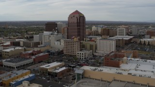 DX0002_127_002 - 5.7K stock footage aerial video reverse view and orbit Albuquerque Plaza office building, Downtown Albuquerque, New Mexico