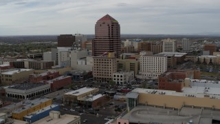 DX0002_127_003 - 5.7K stock footage aerial video orbiting the Albuquerque Plaza and neighboring city buildings, Downtown Albuquerque, New Mexico