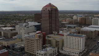 DX0002_127_004 - 5.7K stock footage aerial video approaching the Albuquerque Plaza office building, Downtown Albuquerque, New Mexico