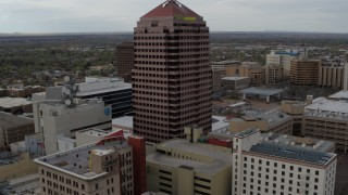 DX0002_127_005 - 5.7K stock footage aerial video flying away from Albuquerque Plaza and neighboring city buildings, Downtown Albuquerque, New Mexico