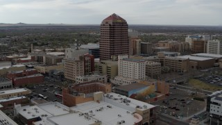DX0002_127_008 - 5.7K stock footage aerial video wide orbit of Albuquerque Plaza high-rise and neighboring city buildings, Downtown Albuquerque, New Mexico