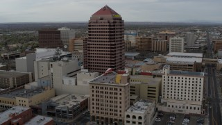 DX0002_127_010 - 5.7K stock footage aerial video fly toward Albuquerque Plaza and neighboring city buildings, Downtown Albuquerque, New Mexico