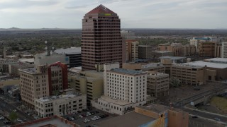 DX0002_127_011 - 5.7K stock footage aerial video orbit and fly away from Albuquerque Plaza and neighboring city buildings, Downtown Albuquerque, New Mexico