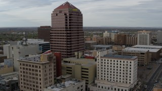 DX0002_127_013 - 5.7K stock footage aerial video of Albuquerque Plaza and other city buildings during descent, Downtown Albuquerque, New Mexico