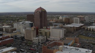 DX0002_127_014 - 5.7K stock footage aerial video reverse view and orbit or Albuquerque Plaza, city buildings, Downtown Albuquerque, New Mexico