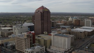 DX0002_127_015 - 5.7K stock footage aerial video approach and orbit Albuquerque Plaza and neighboring city buildings, Downtown Albuquerque, New Mexico