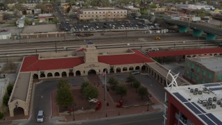 DX0002_127_020 - 5.7K stock footage aerial video of an orbit of the entrance of the Albuquerque train station, Downtown Albuquerque, New Mexico