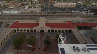 DX0002_127_021 - 5.7K stock footage aerial video of the entrance of the Albuquerque train station, Downtown Albuquerque, New Mexico