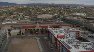 DX0002_127_023 - 5.7K stock footage aerial video orbit and stationary view of the entrance of the Albuquerque train station, Downtown Albuquerque, New Mexico