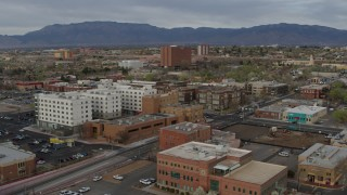 DX0002_127_025 - 5.7K stock footage aerial video of flying by office and apartment buildings, Downtown Albuquerque, New Mexico