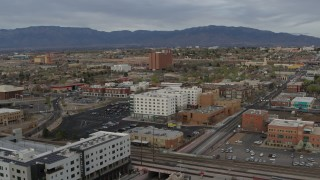 DX0002_127_026 - 5.7K stock footage aerial video of passing office and apartment buildings, Downtown Albuquerque, New Mexico