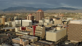 DX0002_127_027 - 5.7K stock footage aerial video fly away from Albuquerque Plaza towering over city buildings, Downtown Albuquerque, New Mexico