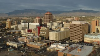 DX0002_127_029 - 5.7K stock footage aerial video approach and flyby Albuquerque Plaza towering over city buildings, Downtown Albuquerque, New Mexico