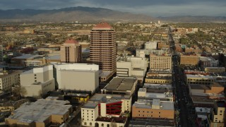 DX0002_127_034 - 5.7K stock footage aerial video circling around Albuquerque Plaza high-rise and city buildings, Downtown Albuquerque, New Mexico