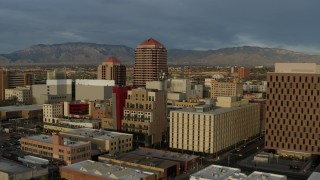 DX0002_127_041 - 5.7K stock footage aerial video orbit office high-rise at the center of city buildings, Downtown Albuquerque, New Mexico